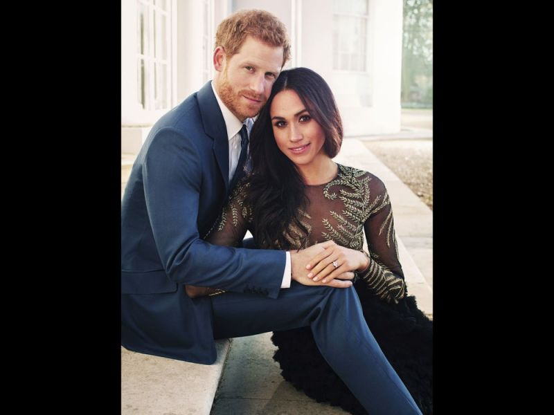 In this photo released by Kensington Palace on Thursday, Dec. 21, 2017, Britain's Prince Harry and Meghan Markle pose for one of two official engagement photos, at Frogmore House, in Windsor, England. (Alexi Lubomirski / AP)