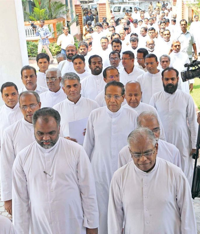 Priests take out a protest march to the Major Archbishop's House in Kochi on Friday.