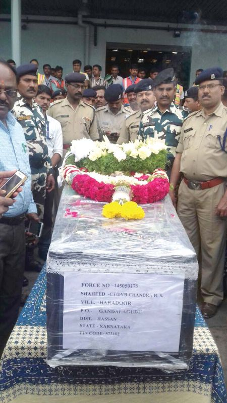 Mortal remains of soldier Chandru have arrived in Hassan and his final rites will be held on Thursday