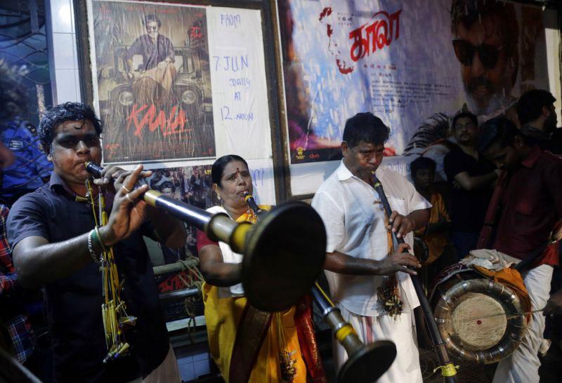 Musicians perform inside a cinema hall during 'Kaala' movie release, the new movie of superstar Rajinikanth, in Mumbai. (Photo: AP)