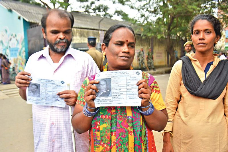 Visually impaired voters after casting their votes at Kamarajar street polling booth, on Thursday. (Photo: DC)