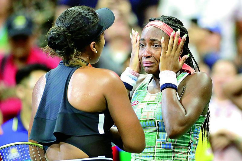 Coco Gauff (right) of USA wipes away tears while talking to Naomi Osaka of Japan after their US Open third round match in New York on Saturday. (Photo: AP)