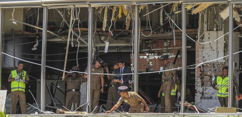A Sri Lankan Police officer inspects a blast spot at the Shangri-la hotel in Colombo, Sri Lanka. (Photo:AP)