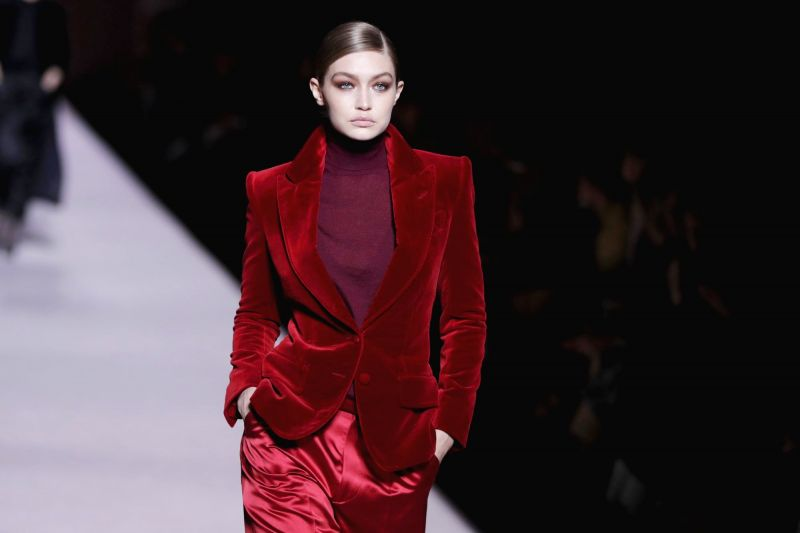Gigi Hadid in beautiful Burgandy Velvet Pant suit from Tom Ford's collection. (Photo: AP)