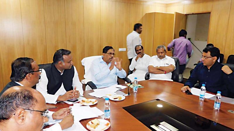 Deputy CM Dr G. Parameshwar, BWSSB Chairman Tushar Girinath and others at the meeting. (Photo: DC)