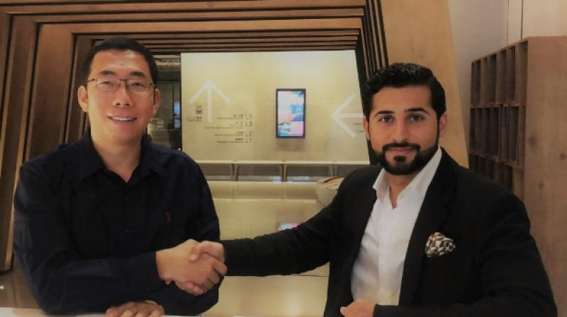Founder and CEO of Xender, Mr. Peter Jiang with the Head of AYGL Group, Mr. Khalifah H. Al-Yaqou, in Beijing