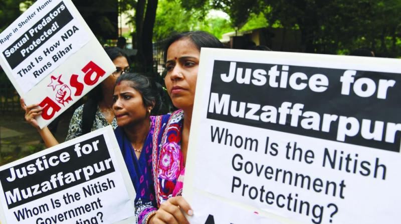 Women rights activists protest in New Delhi on July 30 over the sexual assault of girls at a state-funded shelter home in Muzaffarpur district, Bihar. Police dug up the grounds of the rescue home after allegations that one girl was killed there.