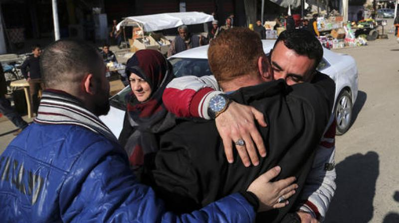 Civilians congratulate each other after they survive the fight between Iraqi security forces and Islamic State militants in a neighborhood recently liberated from the militia on the eastern side of Mosul, Iraq. (Photo: AP)