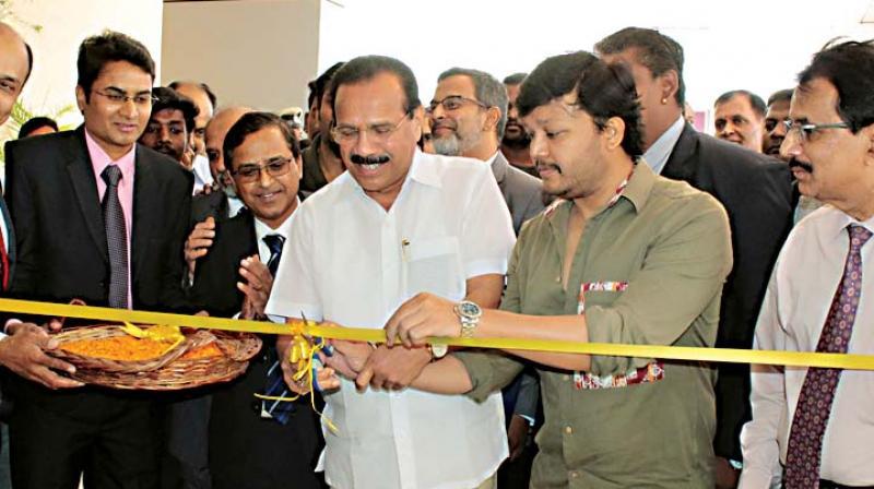Union Minister Sadananda Gowda and actor Ganesh at the inauguraton of a hospital on the Bengaluru-Tumakuru highway on Tuesday.
