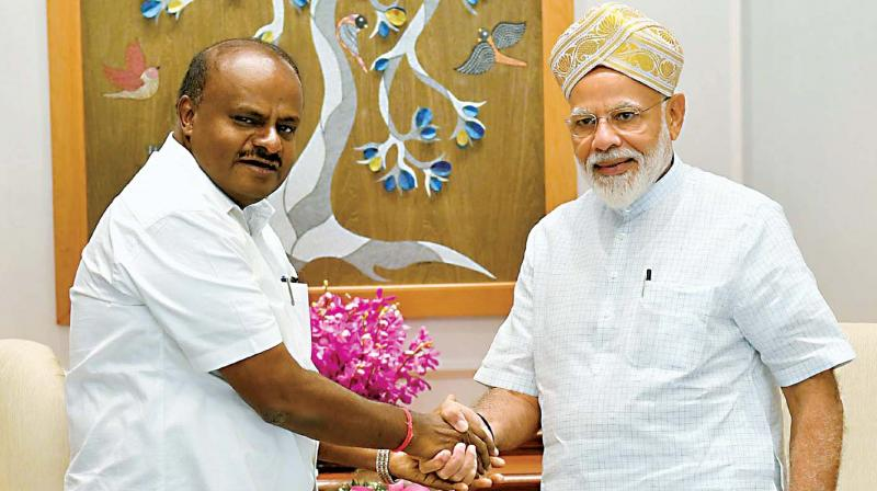 Chief Minister H.D. Kumaraswamy with PM Narendra Modi in New Delhi on Saturday. (Photo: KPN)