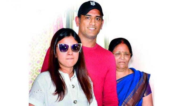 MS Dhoni with his mother and wife Skashi