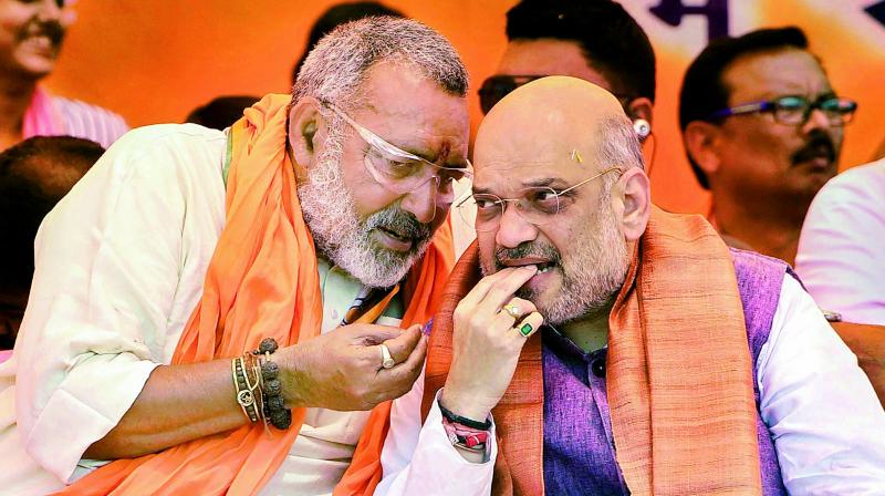 BJP president Amit Shah and party candidate Giriraj Singh during an election campaign rally in Begusarai district on Wednesday.  (PTI)