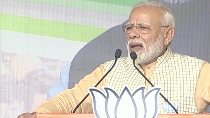 """Prime Minister Narendra Modi on Tuesday launched a blistering attack on the opposition JMM-Congress alliance in Jharkhand, alleging it followed the politics of """"deception"""" while the BJP believed in service of people. (Photo: Twitter/ ANI)"""