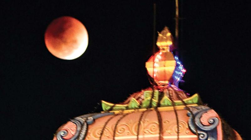 Lunar eclipse, the much awaited blood moon appeared slightly later than expected as people gathered to have a glimpse of rare cosmic wonder in Madurai on Wednesday.