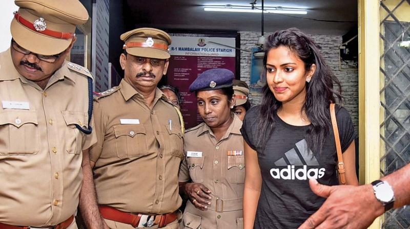 Actress Amalapaul at the Mambalam police  station after lodging a complaint against a  businessman, on Wednesday.  	—DC