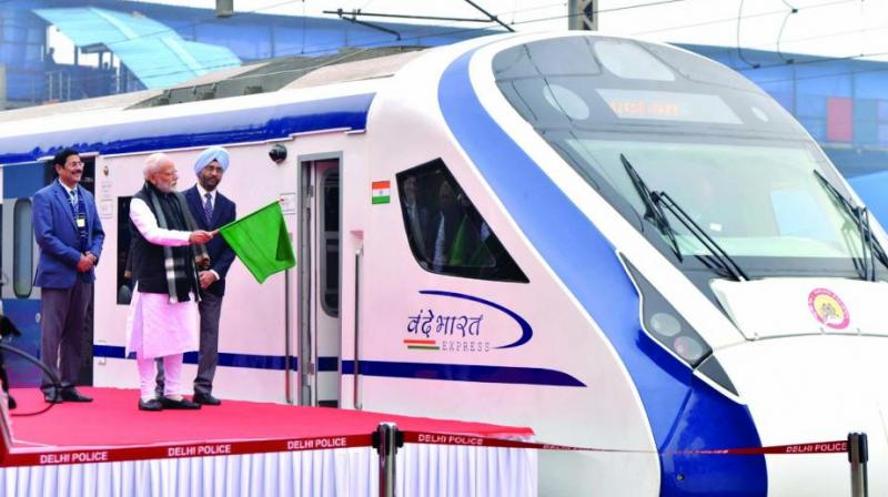 Prime Minister Narendra Modi flags off Vande Bharat Express, India's first semi-high speed train at New Delhi railway station on Friday. The train has been able to attain a maximum speed of 130 kmph during its inaugural run between Delhi and Varanasi, officials said. (Photo: DC)
