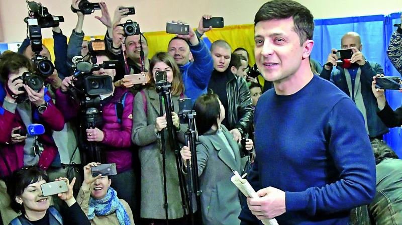 Ukrainian comic actor, showman and presidential candidate Volodymyr Zelensky casts his ballot at a polling station during Ukraine's presidential election in Kiev on Sunday. (AFP)
