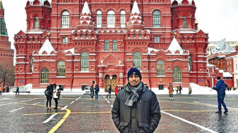 Restaurateur Nikhil Hegde carpooled through Russia and went by road across Europe. Here he poses at the Red Square in Moscow.