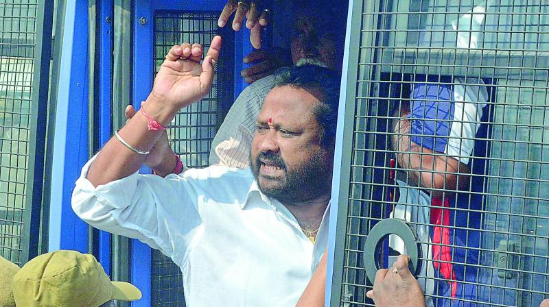 One of RTC union leaders is being arrested by police after they attempted to stage dharna at Gunpark on Sunday. (Photo: DC)