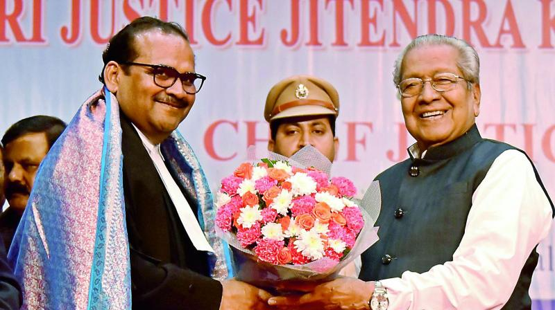 Andhra Pradesh Governor Biswa Bhushan Harichandan presents a bouquet to new Chief Justice of Andhra Pradesh High Court Justice Jitendra Kumar Maheswari after his oath taking ceremony on Monday in Vijayawada. (Photo: DC)