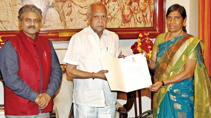 Governor Banwarilal Purohit hands over  appointment order to S. Thamarai Selvi, new VC of Thiruvalluvar University, Vellore, on Tuesday.