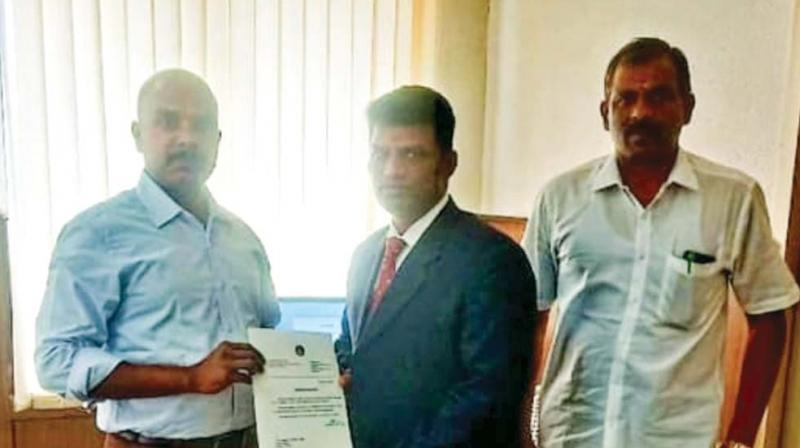 The ticketing staff honoured by IG Railways, Balakrishnan.
