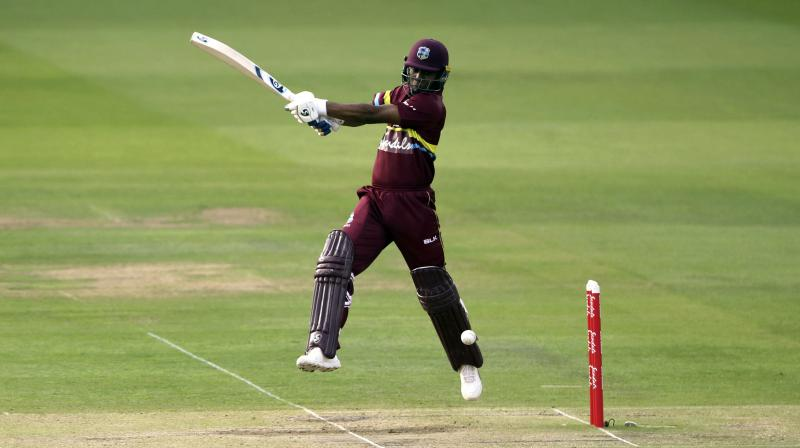 Evin Lewis struck 58 off 26 balls, including five sixes and as many fours in a West Indies' total of 199 for four with Marlon Samuels contributing 43 and Denesh Ramdin 44 not out. (Photo: AP)