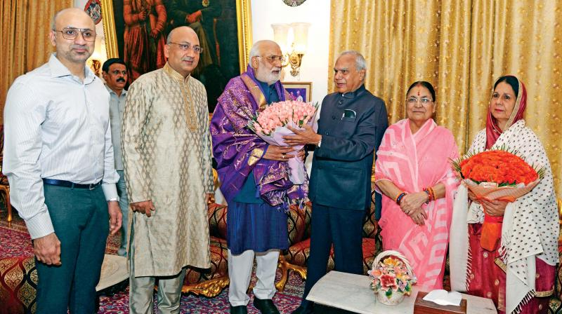 TN Governor Banwarilal Purohit along with his wife Pushpa Purohit on Friday present silk shawl and bouquets to Prince of Arcot, Nawab Mohammed Abdul Ali and his wife Begum Sahiba Sayeeda Abdul Ali at Amir Mahal while wishing them a safe and successful Haj pilgrimage. (Photo: DC)