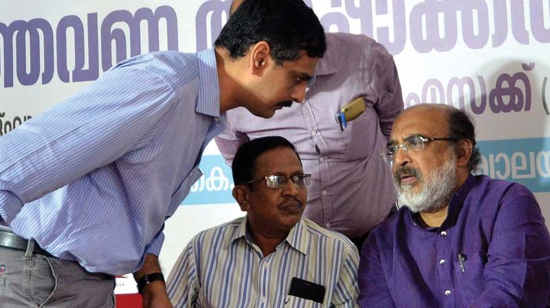Finance minister T.M. Thomas Isaac shares words with KFC general Manager Premnath Ravindranath and Js (Rtd) Satheesh Chandrababu during the inauguration of KFC adalath on Tuesday in Thiruvananthapuram.(Photo: DC)