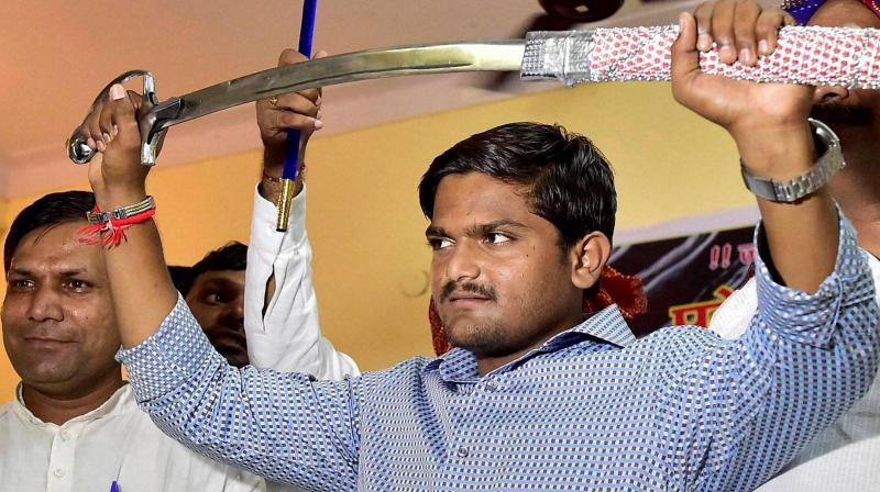 Hardik Patel had earlier set a condition that he would support the Congress in the Assembly polls, due next month, only if the party committed to reservation in education and government jobs for his community. (Photo: PTI/File)