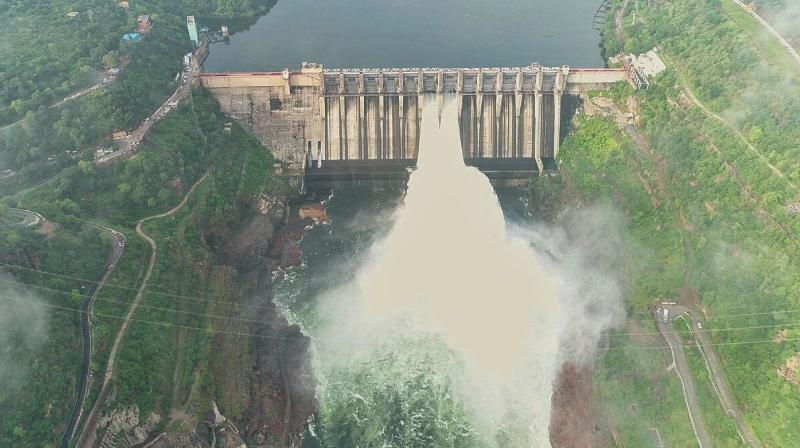 Spillway gate number 6 and 7 of Srisailam were opened by 10 feet at 8 in the morning on Thursday. (Photo: DC)