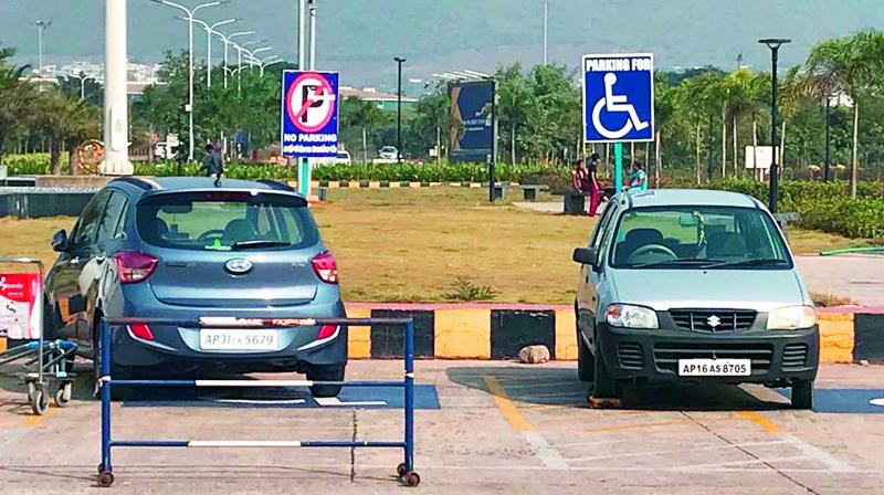 Cars chained for parking at the space reserved for physically challenged persons at Visakhapatnam Airport on Tuesday. (Photo: DC)