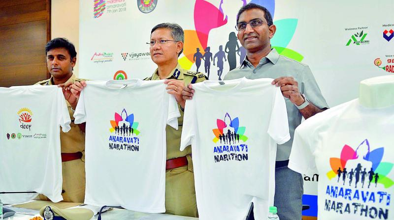 Commissioner of Police D. Gautam Sawang, Marathon director Murali Nannapaneni and DCP Kanthi Rana Tata release Amaravati Marathon T Shirts in Vijayawada on Tuesday. (Photo: DC)