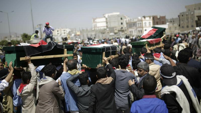 Crowds of men spilled into the streets of the capital where coffins draped with Yemeni flags were lined up. (Photo:AP)