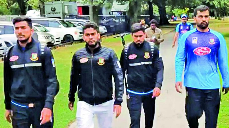 Bangladesh cricketers walk back to the team bus which was halted just a few yards from the mosque. (Photo: Twitter)