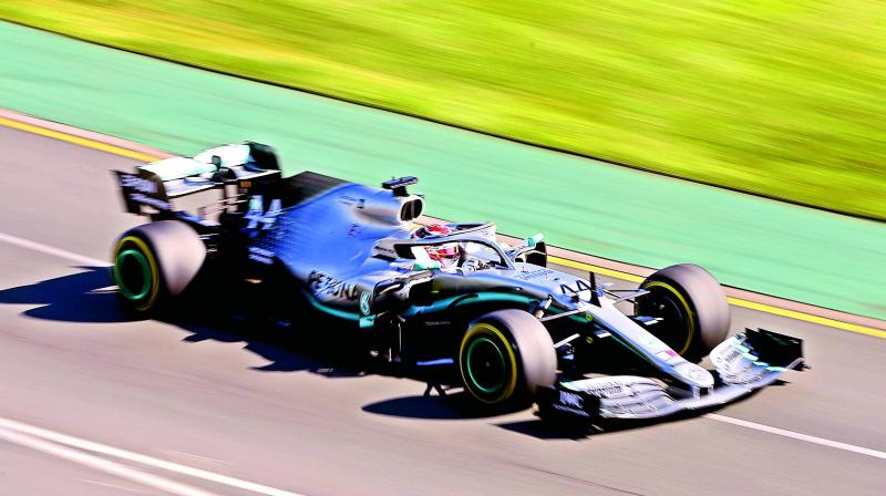 Mercedes driver Lewis Hamilton of Britain goes through a turn during the second practice session of the Australian Grand Prix in Melbourne on Friday. The first race of the season will be held on Sunday. (Photo: AP)