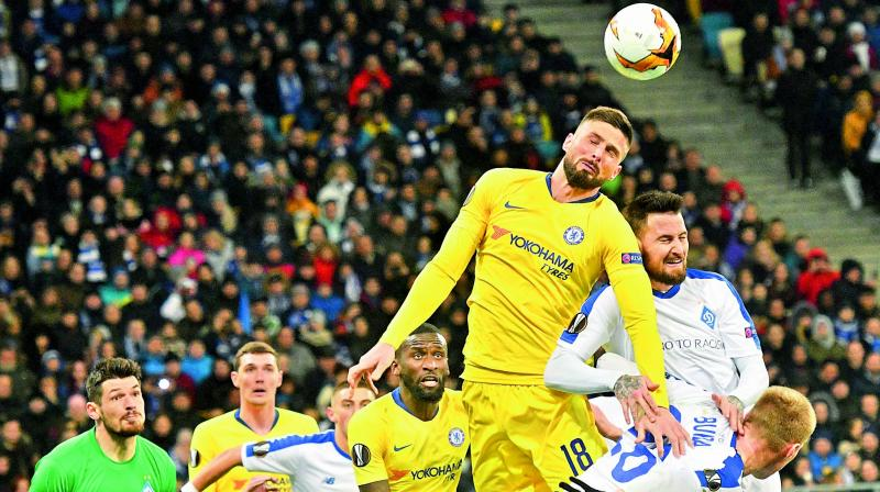 Chelsea's French forward Olivier Giroud (second from right) and Dynamo Kiev's Hungarian defender Tamas Kadar (right) fight for the ball during their Europa League Round of 16 second leg match at the NSK Olimpiyskyi Stadium in Kiev on Thursday. Chelsea won 5-0 to progress 8-0 on aggregate. (Photo: AFP)