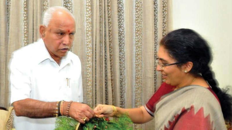 BJP's probable candidate for Bengaluru South Tejaswini Ananthkumar calls on state BJP president B.S. Yeddyurappa in Bengaluru on Friday. (Photo: KPN)