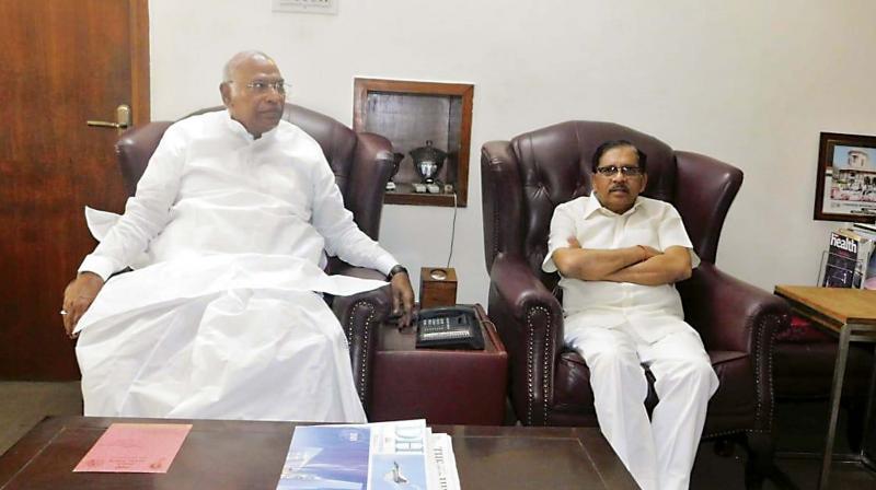 Dy CM Dr G Parameshwar with senior Congress leader M. Mallikarjun Kharge at the latter's residence on Friday.