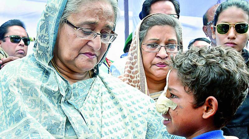 We don't even need to look as far as Japan to see a daughter who has taken her father's legacy proudly forward — Sheikh Hasina, daughter of Sheikh Mujibur Rahman. (Photo: AP)