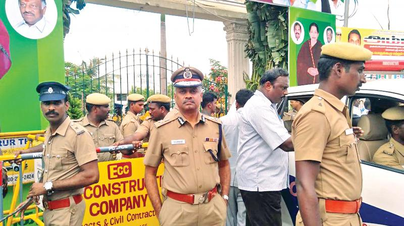 City Police Commissioner A.K. Viswanathan monitors the security operations outside the AIADMK meeting venue on Tuesday. (Photo: DC)