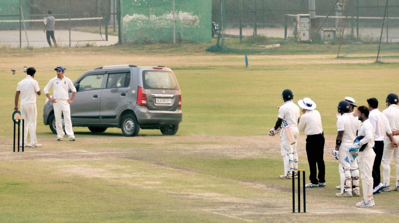 The man, who identified himself as Girish Sharma, tried to swerve his car twice on the 22-yard strip before he was stopped. (Photo: PTI)