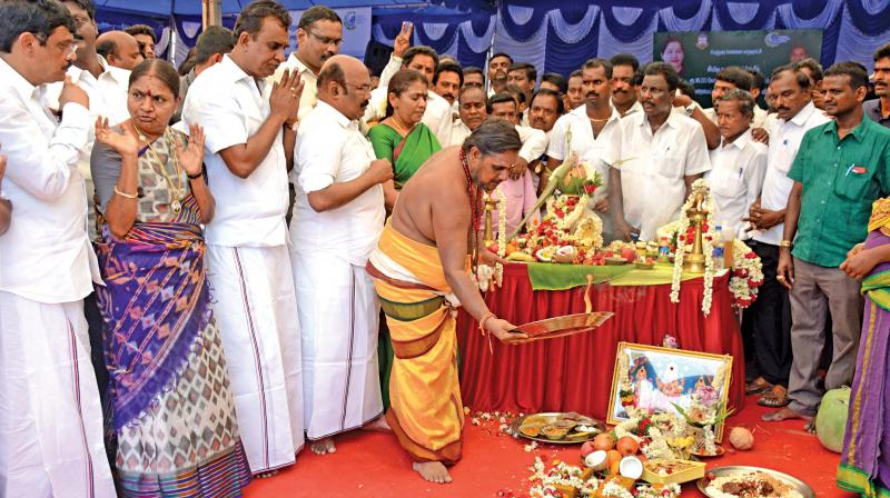 Priest performs a special puja to mark the inaugural of Villivakkam lake restoration work.  Ministers S. P. Velumani, D. Jayakumar and corporation commissioner Dr D. Karthikeyan take part in the event. (Photo:DC)