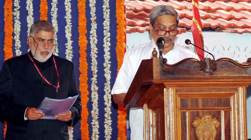 BJP leader Manohar Parrikar taking oath as Goa's new Chief Minister (Photo: PTI)