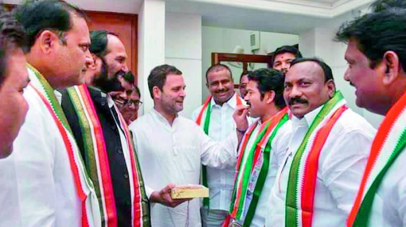 Congress vice-president Rahul Gandhi welcomes A. Revanth Reddy to the party fold with sweets, at his residence in New Delhi on Tuesday. (Photo: DC)
