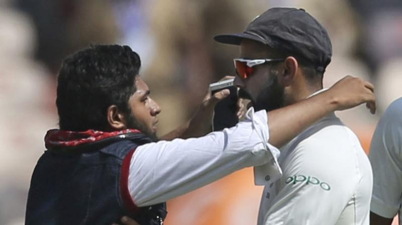 A case of trespassing was slapped against 19-year-old Mohammad Khan, who breached security cordon to get up close with Virat Kohli on Day 1 of the second India versus West Indies Test in Hyderabad. (Photo: AP)