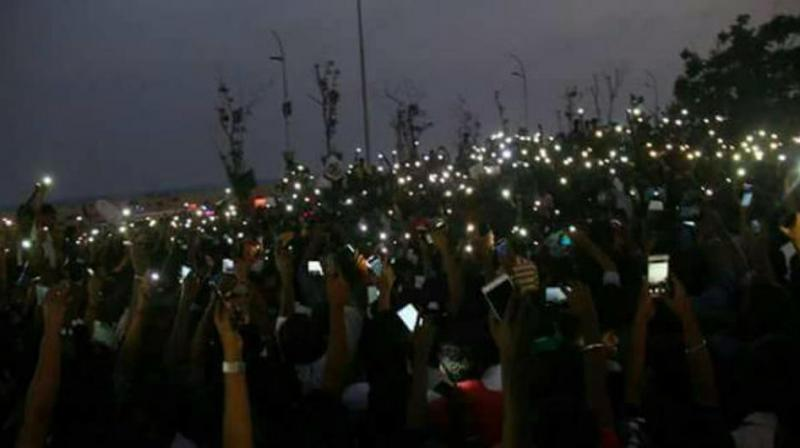 Images of people sleeping at the Marina beach on the first night of the protest, and the now iconic image of youngsters flashing their phone lights, were shared and re-shared with religious reverence. (Photo: Twitter)
