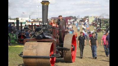 The Great Dorset Steam Fair, covering 600 acres of land and running for 5 days, is an annual show featuring steam-powered vehicles and machinery. (Photos: AP/ Facebook)