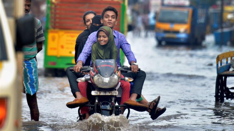 After a brief hiatus from the incessant rains, Chennai and other parts of coastal Tamil Nadu witnessed another spell of heavy downpour on Friday evening. (Photo: PTI)
