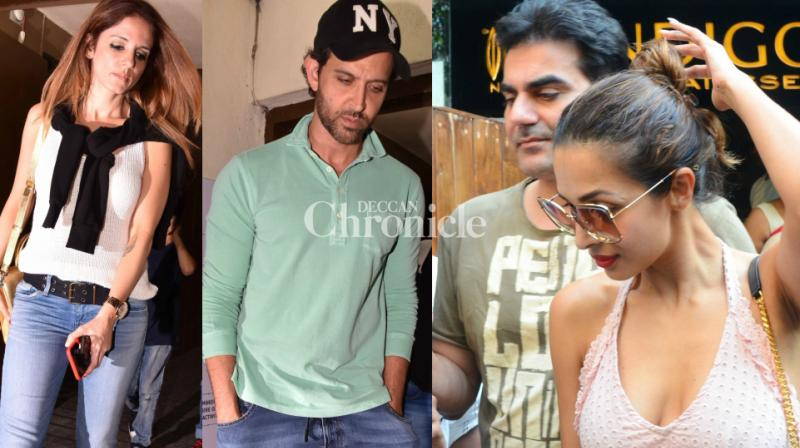 Two estranged couples, Hrithik Roshan-Sussanne Khan and Malaika Arora-Arbaaz Khan were snapped at separate locations bonding along with their respective family members in Mumbai on Sunday. (Photo: Viral Bhayani)